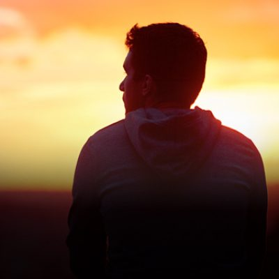 Profile of young man at sunset